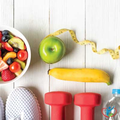 Healthy-diet-exercise-equipment-fruit-water-tape-measure